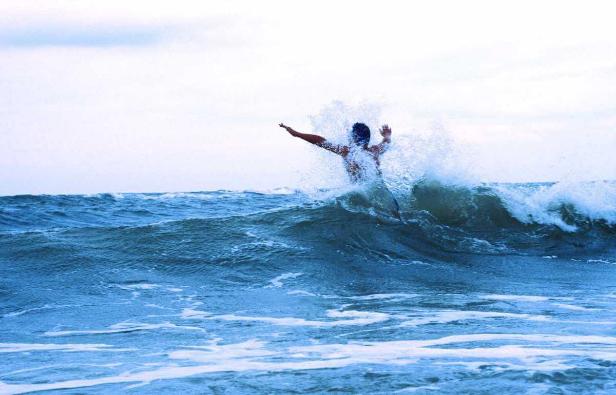 Man running in the waves. © KV Juist
